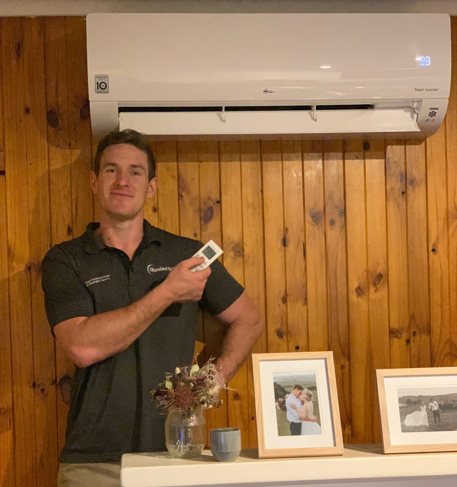 Gippsland Solar's Mitch Richardson with LG WH24 7.1kW reverse cycle split system